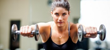 A shot of a woman working out  in the gym